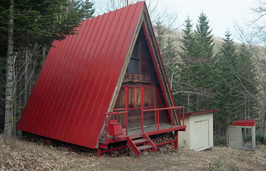 small red a frame hut tiny house swoon