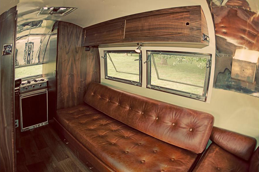 Restored Airstream Bambi on Modern Cob House Interior