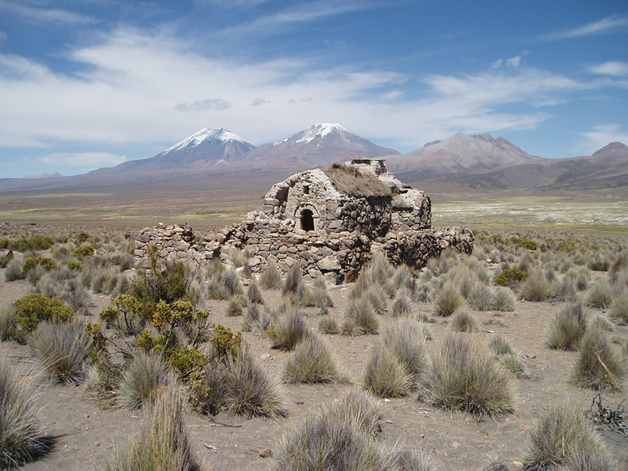 B48-Deserted-house-at-Sajama-with-twin-volcanos-behind