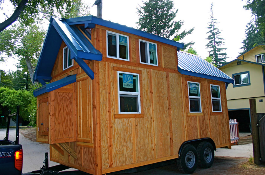 136 square feet tiny house on wheels built by Molecule Tiny Homes .